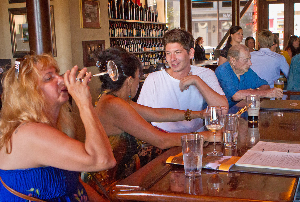 People enjoy wine and beer during Happy Hour at the Bounty Hunter in Napa, Calif., i on Wednesday, August 8th, 2012.