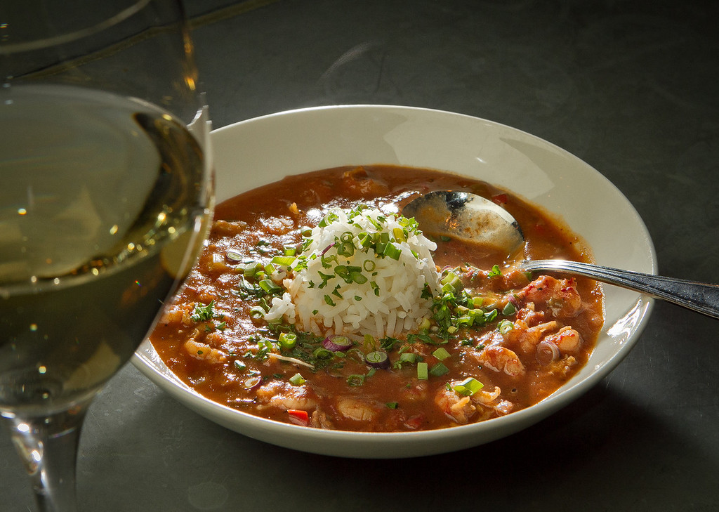 The Crawfish Etouffee with a glass of white wine at the Boxing Room Restaurant in San Francisco, Calif.,  is seen on Wednesday, December 21st,  2011.