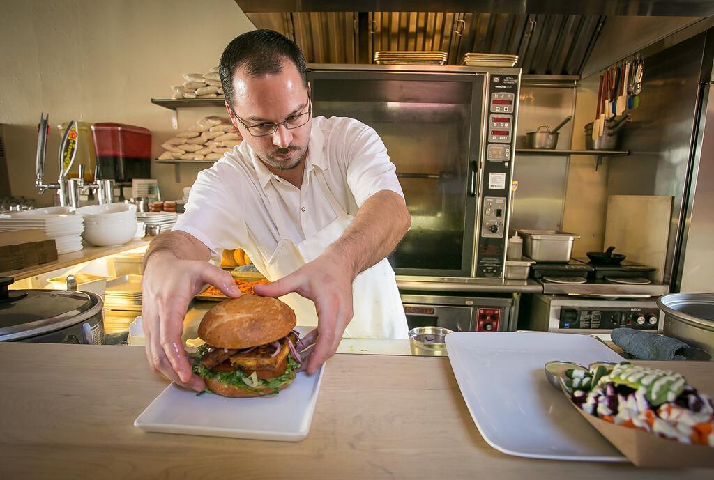 Chef/owner Chris Laramie plates the Tofu sandwich at Brasa restaurant in Berkeley, Calif. on Saturday, January 26th, 2013.