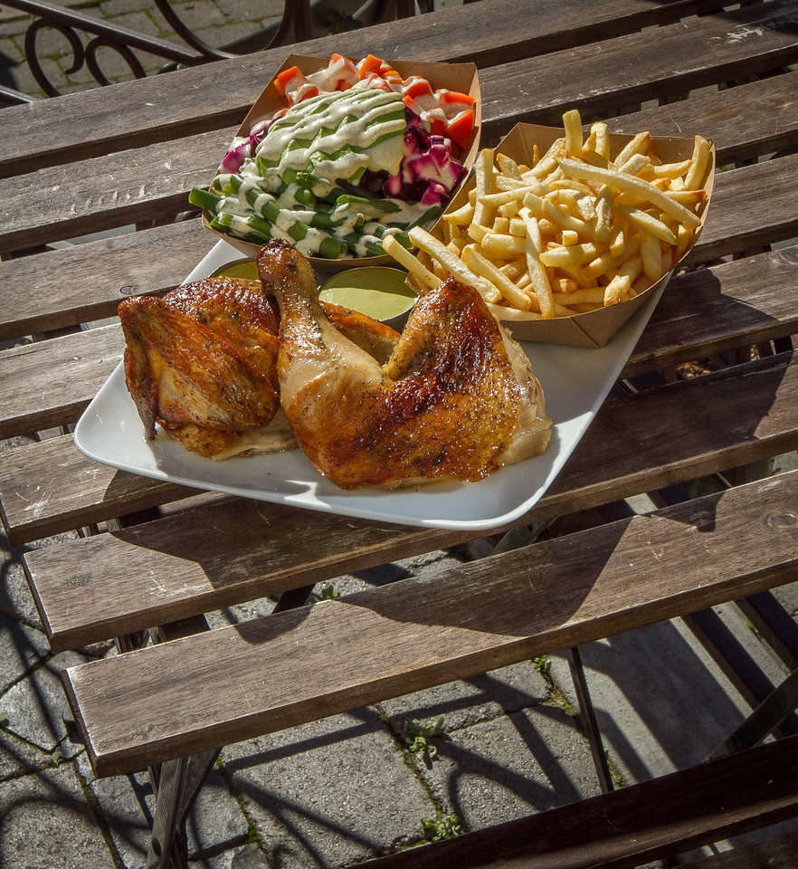 The 1/2 Chicken with a side salad and fries at Brasa restaurant in Berkeley, Calif.  is seen on Saturday, January 26th, 2013.