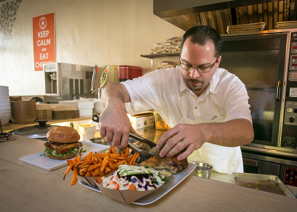 Chef/owner Chris Laramie plates the 1/2 Chicken with two sides at Brasa restaurant in Berkeley, Calif. on Saturday, January 26th, 2013.