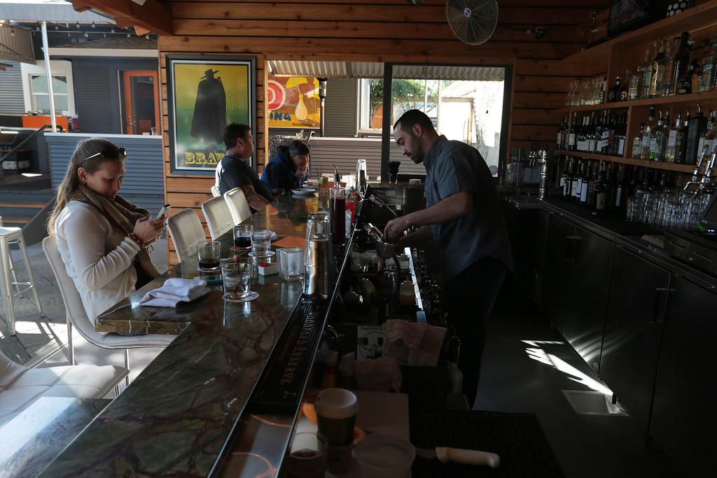 People enjoy lunch at the outside bar at  Bravas Bar de Tapas in Healdsburg, Calif. on Sunday, February 10th, 2013