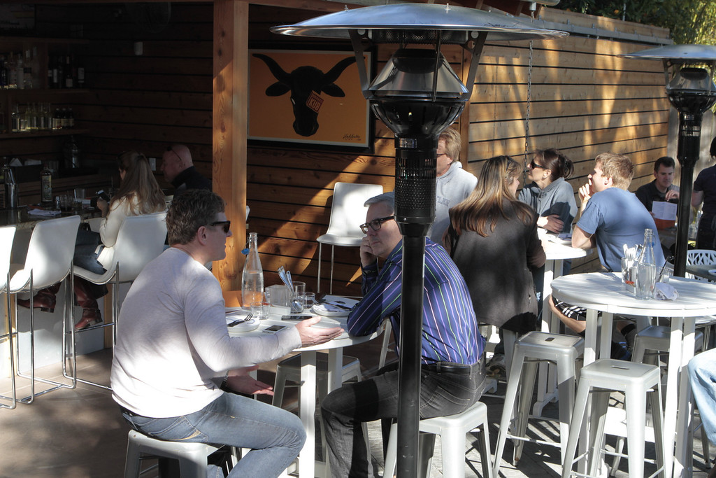 People enjoy lunch on the patio at  Bravas Bar de Tapas in Healdsburg, Calif. on Sunday, February 10th, 2013