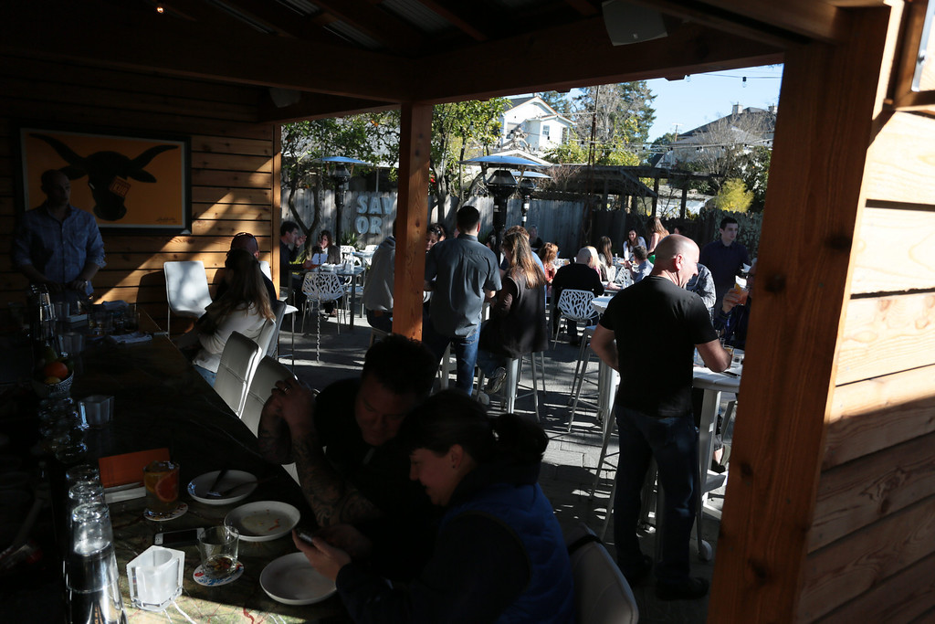 People enjoy the outside bar and patio at  Bravas Bar de Tapas in Healdsburg, Calif. on Sunday, February 10th, 2013