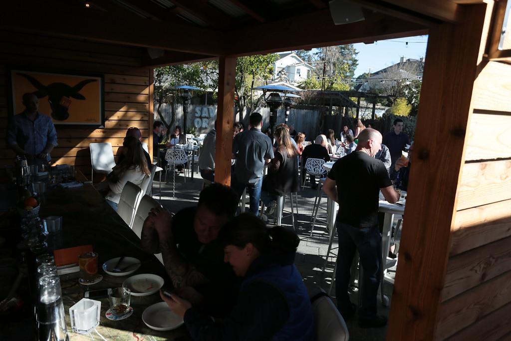 People enjoy the outside bar and patio at  Bravas Bar de Tapas in Healdsburg, Calif. on Sunday, February 10th, 2013