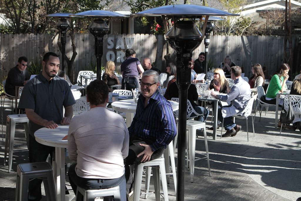 People enjoy lunch on the patio at  Bravas Bar de Tapas in Healdsburg, Calif. on Sunday, February 10th, 2013