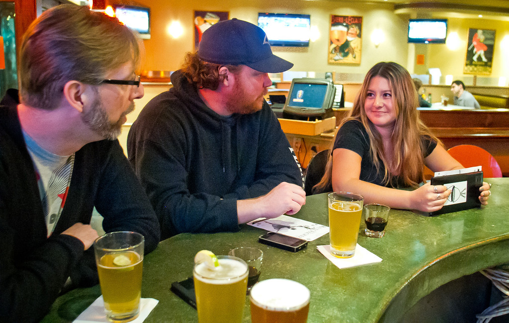 Customers enjoy happy hour at the Broken Drum Brewery in San Rafael, Calif., on Wednesday, November 7th, 2012.