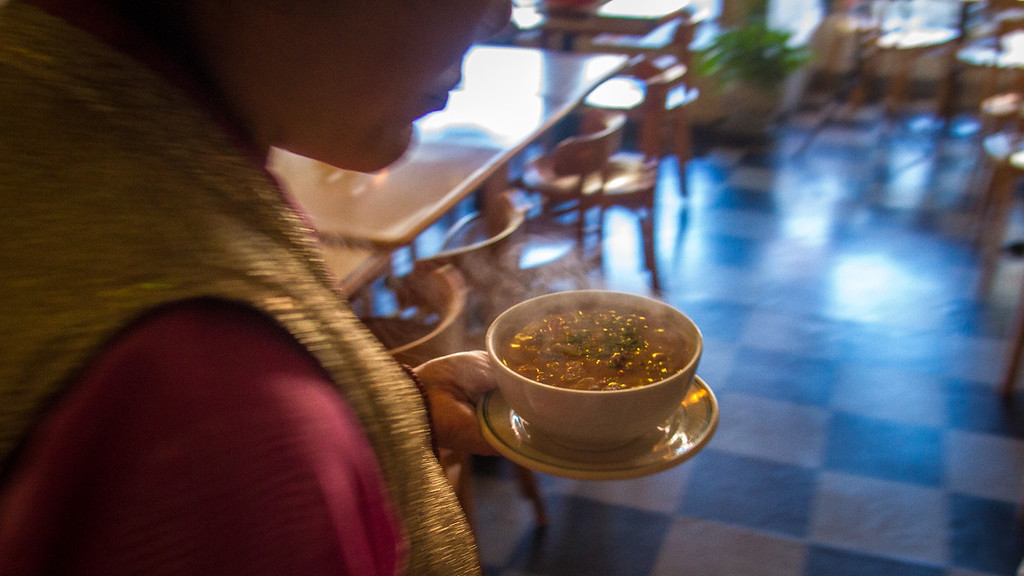 Soup being brought out of the kitchen at Cafe Tibet in Berkeley, Calif. on Thursday, December 13th, 2012.