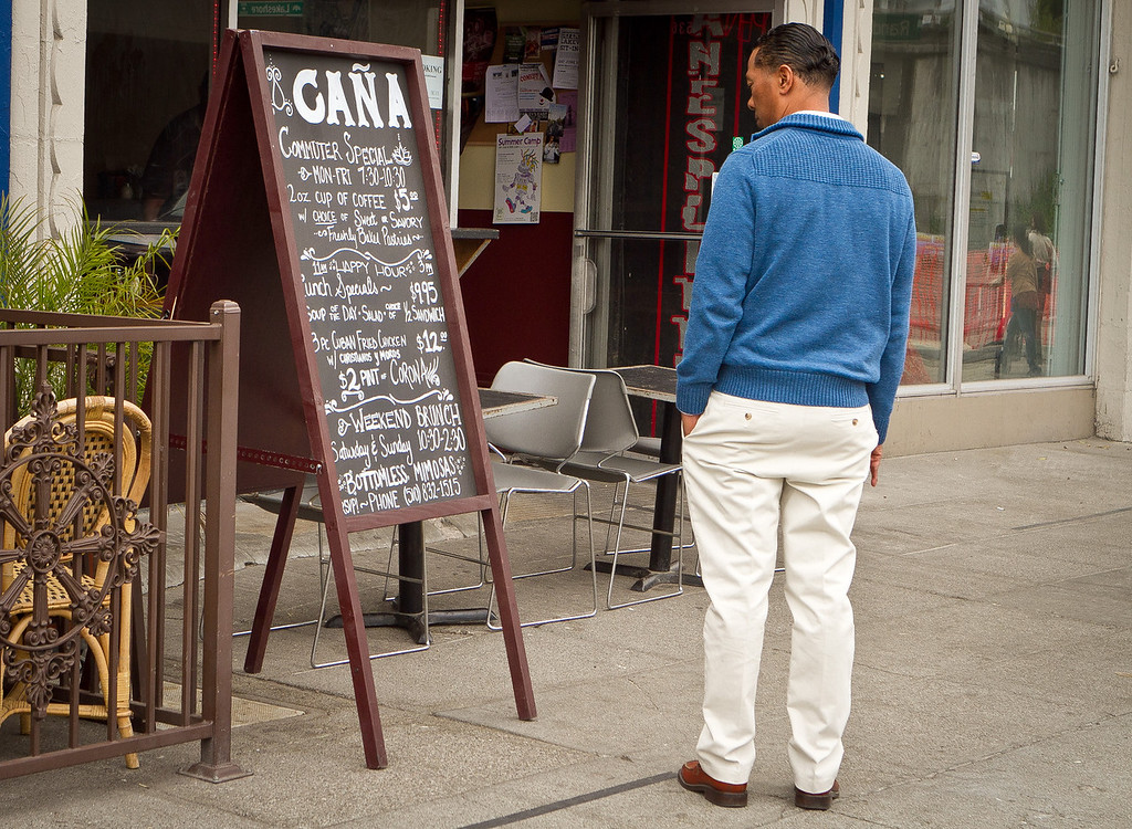 A man looks at the specials board at Cana Cafe in Oakland, Calif., on Friday, June 22nd, 2012.