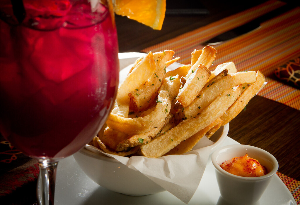 French Fries with Garlic Paprika Aioli and a glass of Sangria at Canela Restaurant in San Francisco, Calif.,  is seen on Saturday, December 3rd,  2011.
