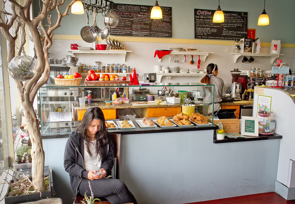 A woman waits for her food inside of the Cassava Bakery & Cafe in San Francisco, Calif., on Saturday, August 18th, 2012.