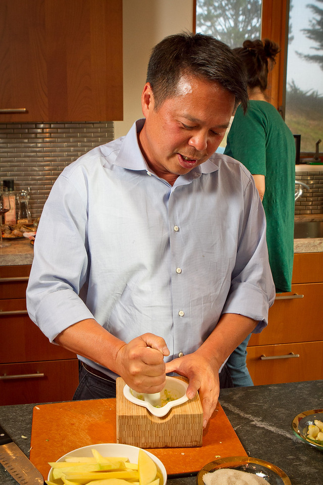 Chef Charles Phan makes dressing in a mortar and pestle for the Mango Salad at a home in Mill Valley on Tuesday, September 11th, 2012.