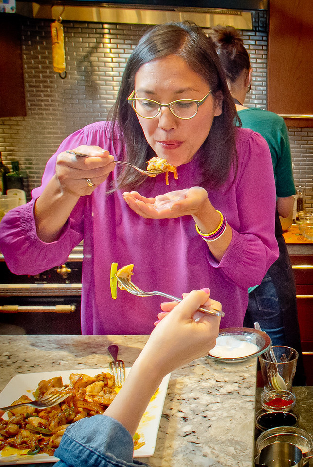 Michelle Magat Williams tastes the Lemongrass Chicken at a home in Mill Valley on Tuesday, September 11th, 2012.