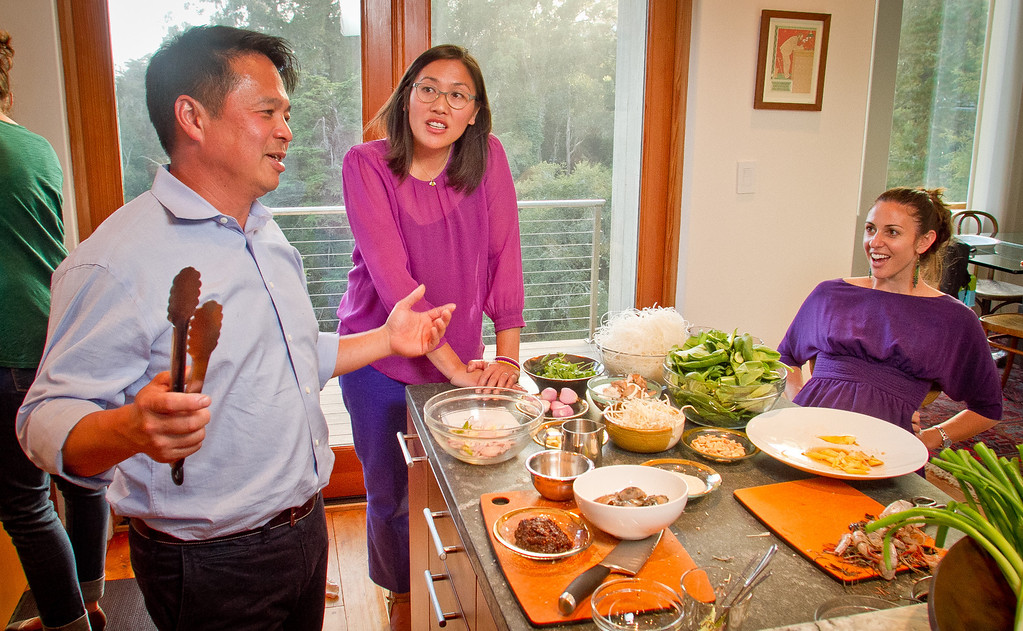 Chef Charles Phan talks about cooking with Michelle Magat William, (glasses), and Shira Weissman while cooking Vietnamese food from his cook book at a home in Mill Valley on Tuesday, September 11th, 2012.