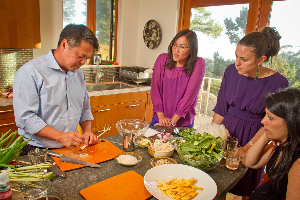 Chef Charles Phan demonstrates how to cut lemongrass to Michelle Magat William, (glasses), Shira Weissman and Jen Strasburg while cooking Vietnamese food from his cook book at a home in Mill Valley on Tuesday, September 11th, 2012.