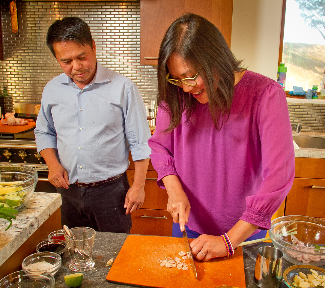Chef Charles Phan watches Michelle Magat Williams cut lemongrass while making Vietnamese food from his cook book at a home in Mill Valley on Tuesday, September 11th, 2012.
