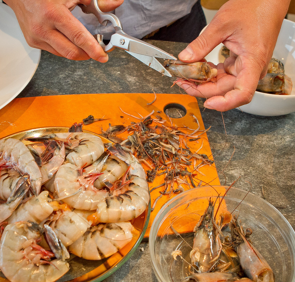 Chef Charles Phan cleans Shrimp heads for making Carmelized Lemongrass Shrimp from his cook book at a home in Mill Valley on Tuesday, September 11th, 2012.