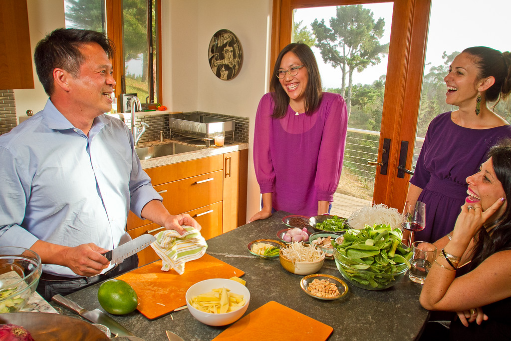 Chef Charles Phan talks with Michelle Magat William, (glasses), Shira Weissman and Jen Strasburg while cooking Vietnamese food from his cook book at a home in Mill Valley on Tuesday, September 11th, 2012.