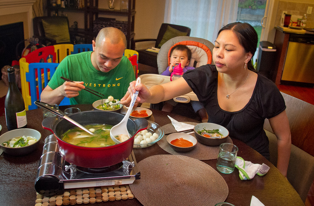 Chef James Syhabout and Stacy Ly with their baby, Emma Syhabout eat a traditional Thai Hot Pot at their home in Oakland, Calif., on Tuesday, May 1st, 2012.