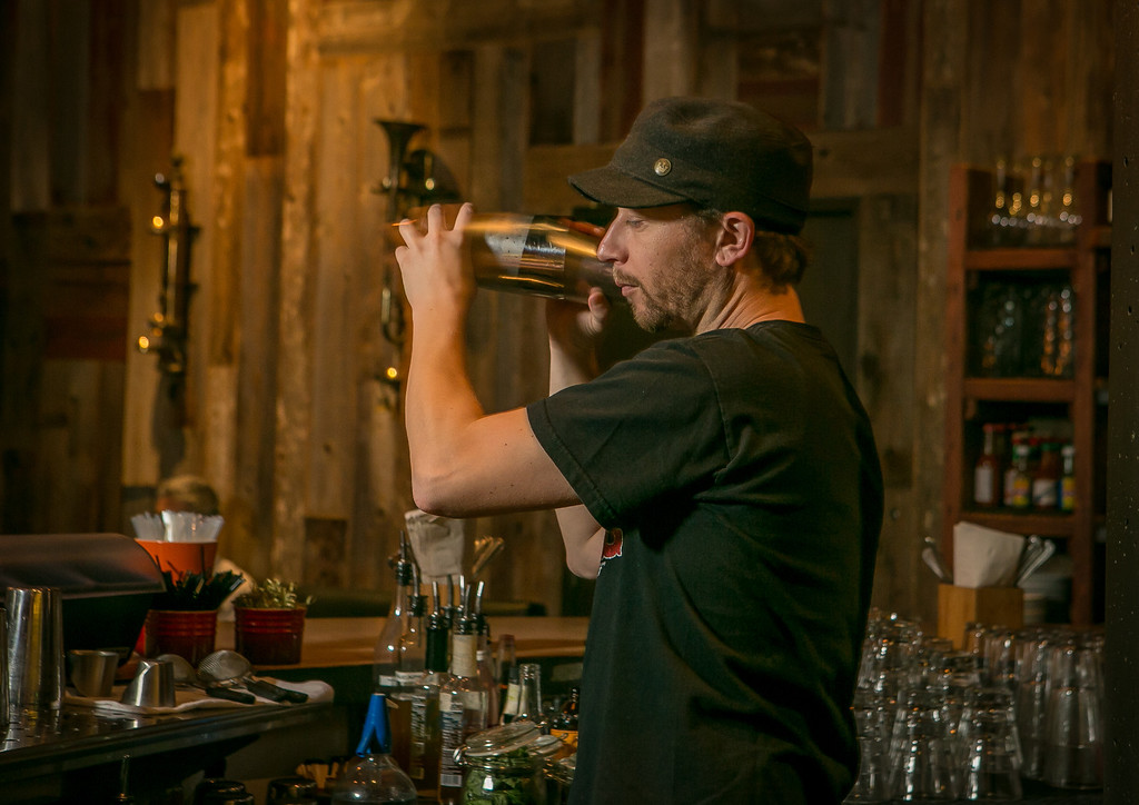 Bartender Erik Ginther shakes a cocktail at the Chop Bar in Oakland, Calif., on Thursday, February 7th, 2013.