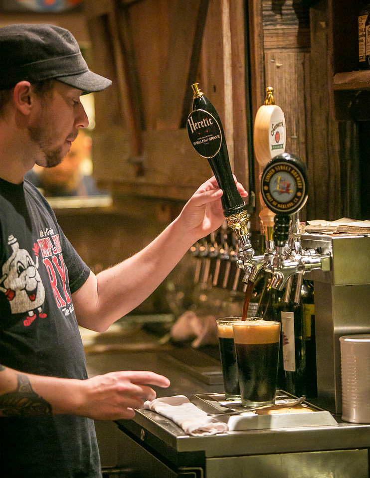 Bartender Erik Ginther pours a beer at Chop Bar in Oakland, Calif., on Thursday, February 7th, 2013.