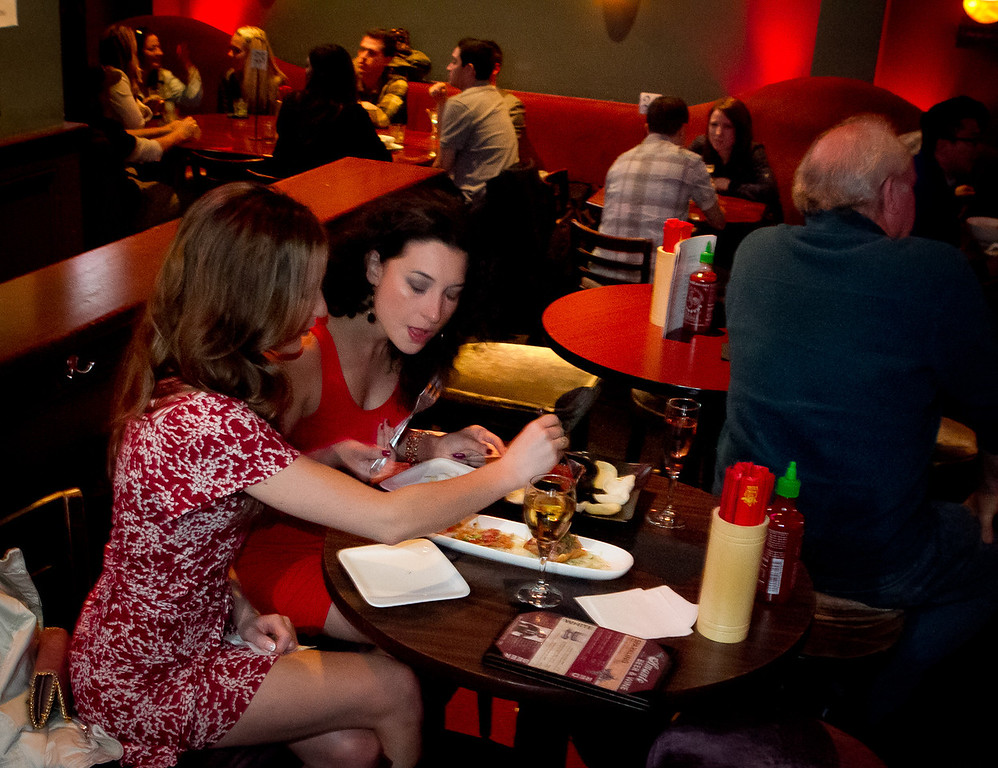 Camila Perez and Jacquie Siegel, right, enjoy food at Chubby Noodles within Amante Bar in San Francisco, Calif., on Saturday, February 25th, 2012.