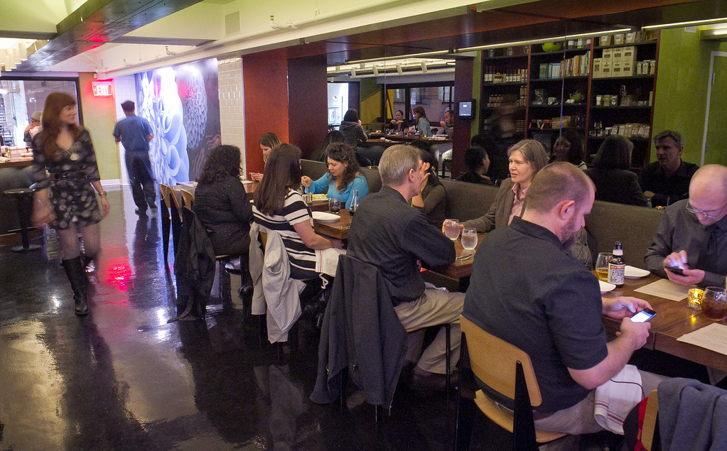 Diners enjoy dinner at Claudine Restaurant in San Francisco, Calif., on Monday, March 5th, 2012.