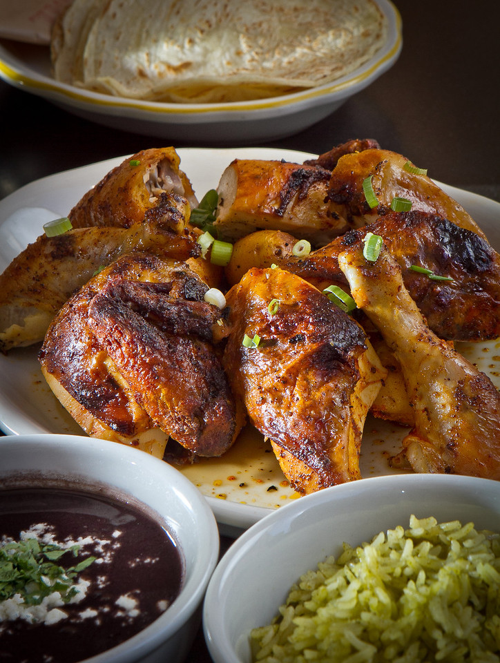 The Spit-Roasted Fulton Valley Chicken with Rice, Beans and Tortillas at Comal Restaurant  in Berkeley, Calif., is seen on Tuesday, July 3rd, 2012.