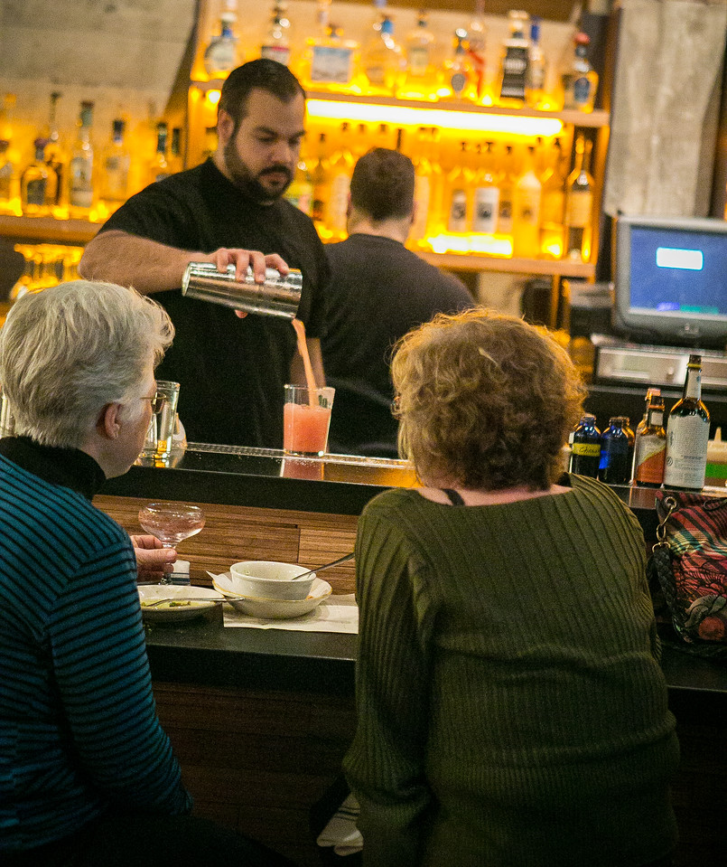 Bartender Matthew Barba pours a cocktail in the front bar at Comal restaurant in Berkeley, Calif., on Thursday, January 10th, 2013.