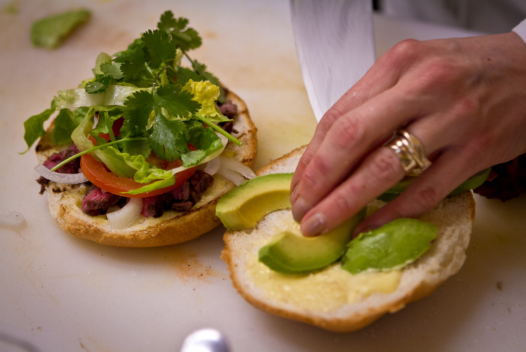 Avocado  is added to a Beef Torta at Cosecha Restaurant in Oakland, Calif., on Friday, January 6th,  2012.