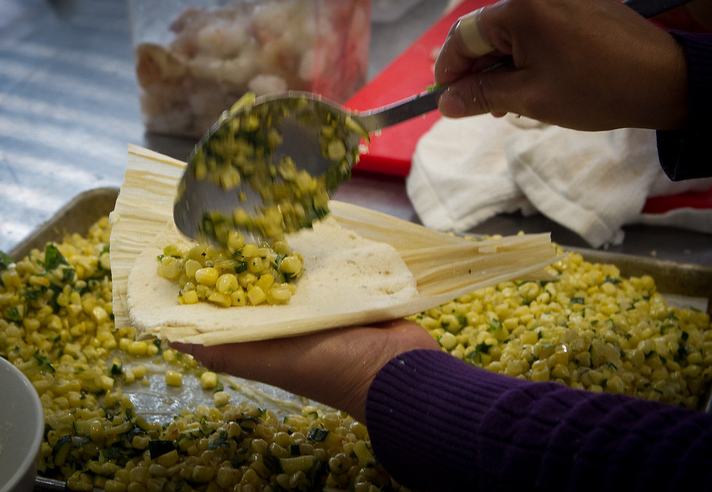 A Tomale being filled with corn at Cosecha Restaurant in Oakland, Calif., on Friday, January 6th,  2012.