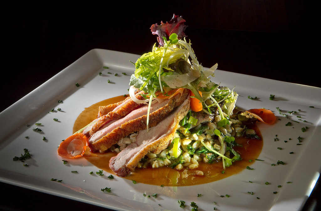 The Roasted Breast of Duck with Farro Risotto at Cypress restaurant in Walnut Creek, Calif.,  is seen on Friday, December 16th,  2011.