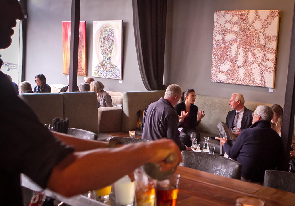 People enjoy cocktails at District in Oakland, Calif.,  on Thursday, October 11th, 2012.