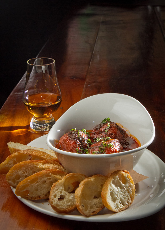 The Lamb Meatballs with a shot of Whiskey at District in Oakland, Calif., are seen on Thursday, October 11th, 2012.