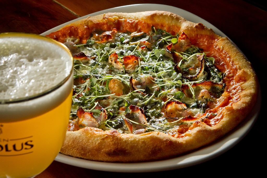 The Guanciale Pizza with a beer at District in Oakland, Calif., is seen on Thursday, October 11th, 2012.