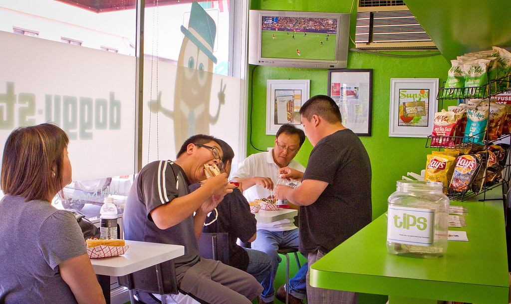 Customers have lunch at Doggy-Style Hot Dogs in Alameda, Calif. on Thursday, August 9th,  2012.