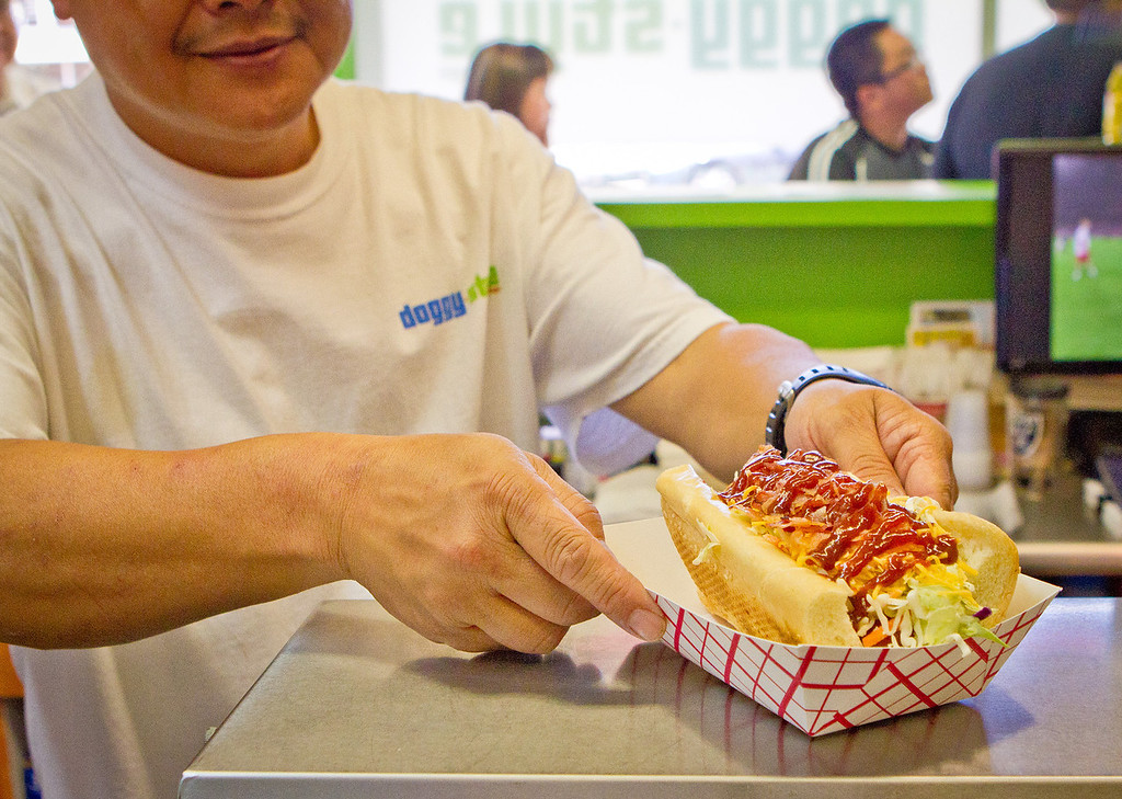 Milton Pang grabs an All American hot dog at Doggy-Style Hot Dogs in Alameda, Calif. on Thursday, August 9th,  2012.