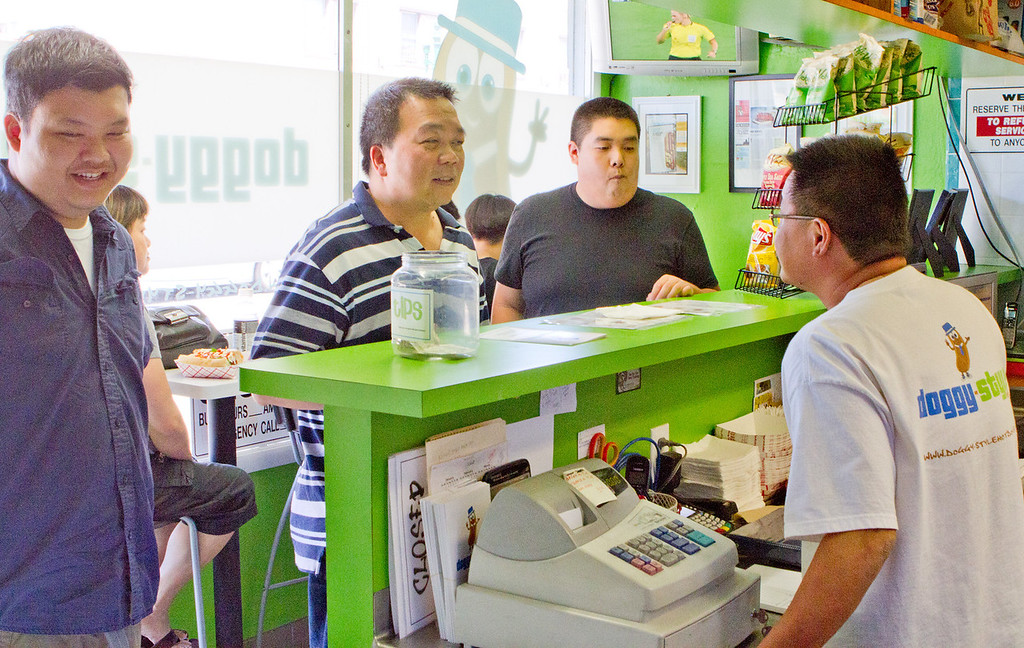 Customers order hot dogs from owner Milton Pang at Doggy-Style Hot Dogs in Alameda, Calif. on Thursday, August 9th,  2012.