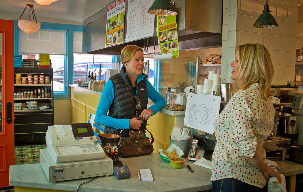 Owner Karen Waikiki talks with a customer at El Molina Central in Boyes Hot Springs, Calif. on April 12th, 2012.