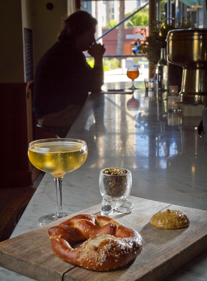 The Champagne Cocktail with the Fried Capers and the warm Pretzel at Fat Angel in San Francisco, Calif., is seen on Wednesday, June 20th, 2012.