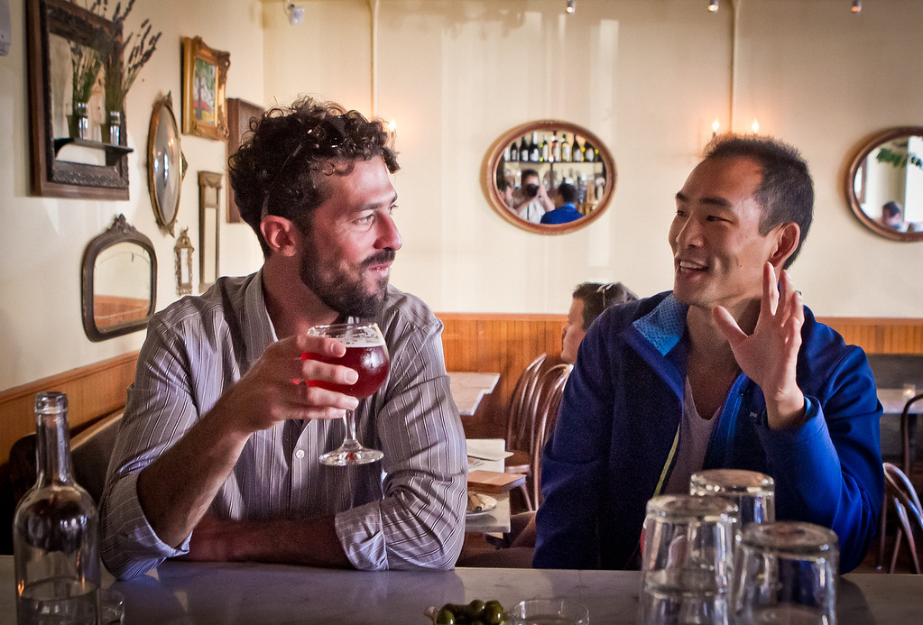 Nick Tumilowicz, left, and Joe Song have a beer at Fat Angel in San Francisco, Calif., on Wednesday, June 20th, 2012.