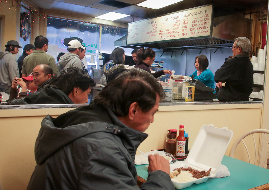 Customers enjoy lunch at Fil-Am Cuisine in Daly City, Calif., on Friday, November 16th, 2012.