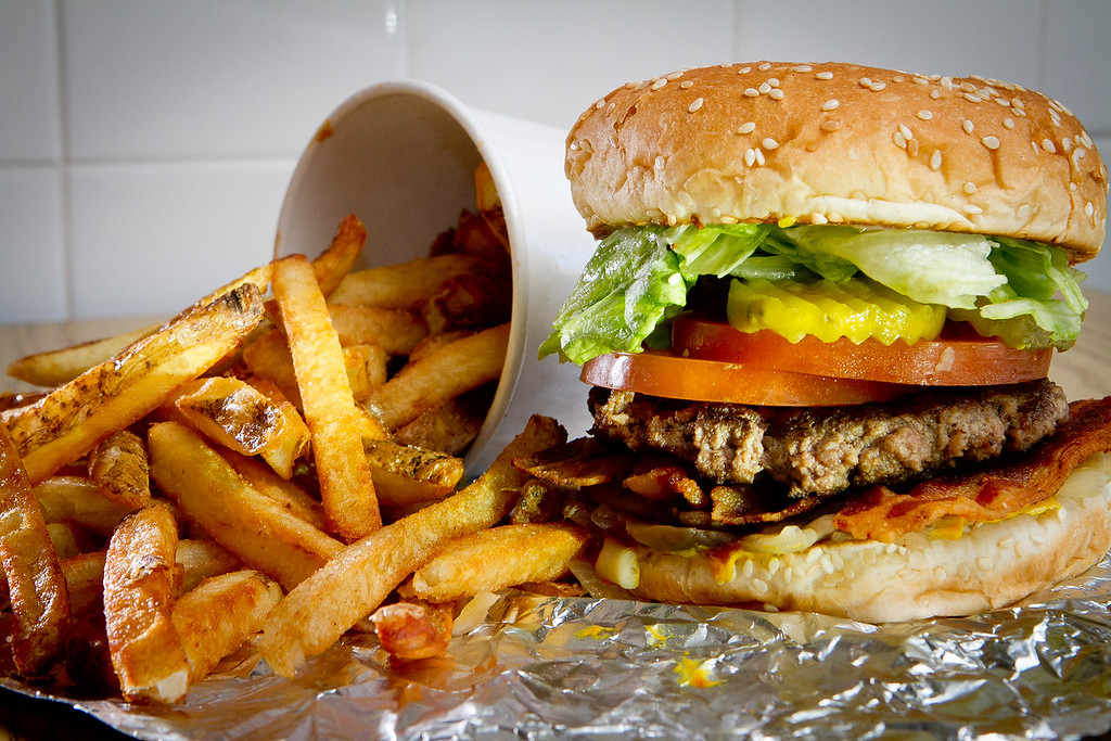 "A regular burger with toppings  ""All the Way"" and french fries at Five Guys Burgers in Burlingame, Calif., is seen on Thursday, February 2, 2012."