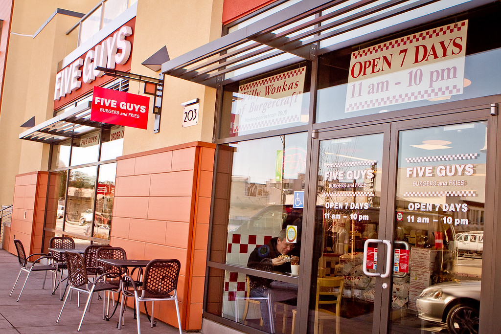 The exterior of Five Guys Burgers in Burlingame, Calif., is seen on Thursday, February 2, 2012.