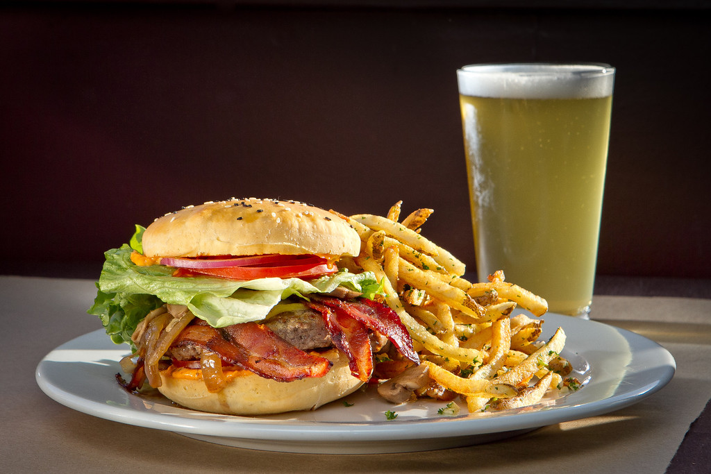 "The ""All American"" Burger with a beer at Flavor Restaurant in El Granada,  Calif., is seen on Thursday, March 22nd, 2012."