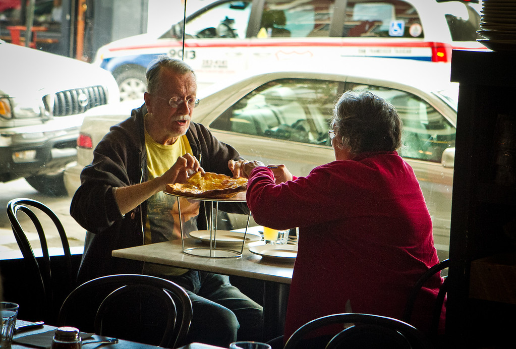 A couple shares a pizza at Giola Pizzeria in San Francisco, Calif., on Friday, June 22nd, 2012.