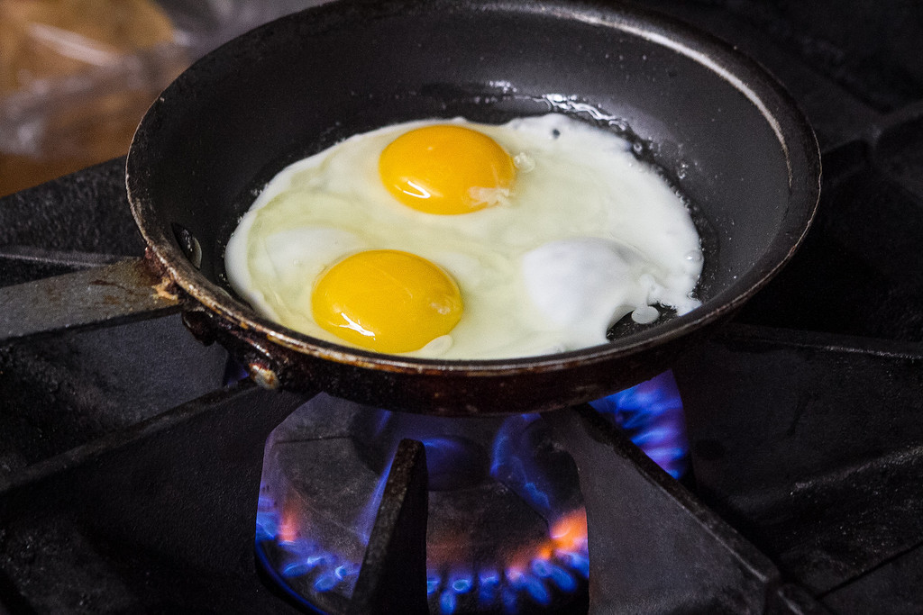 Eggs being fried for the Big Island plate at Grindz restaurant in San Francisco, Calif., on Thursday, January 10th, 2013.