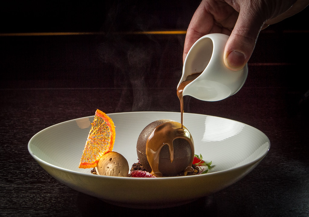 Warm chocolate being poured over the Chocolate Orange dessert at Hakkasan restaurant in San Francisco, Calif. is seen on Wednesday, January 23rd, 2013.