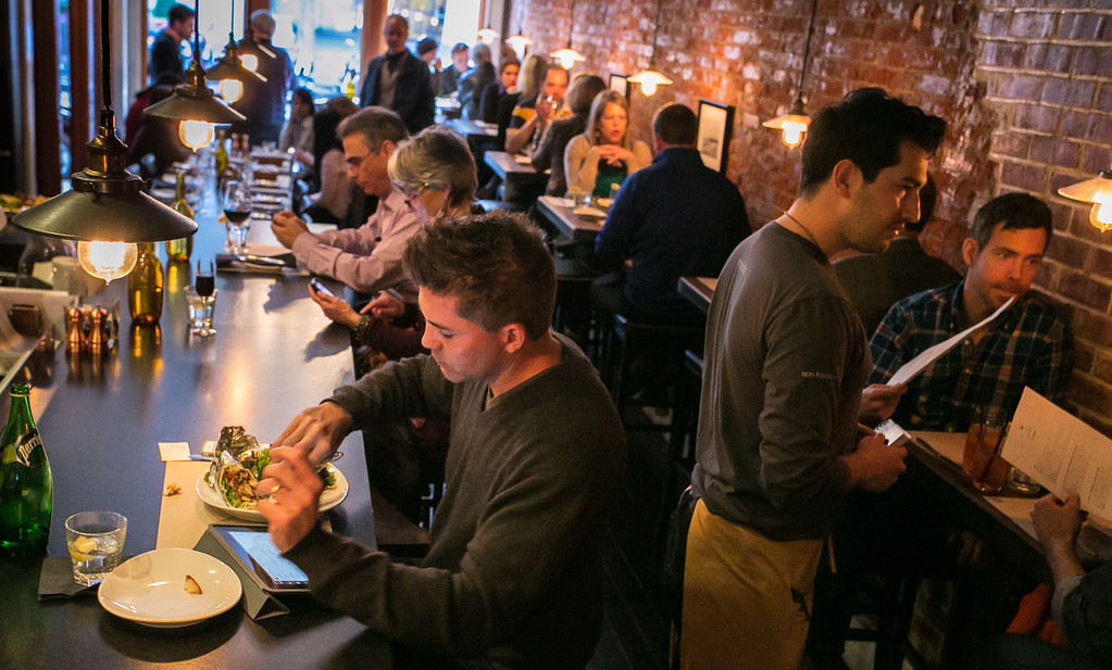 People enjoy lunch at Machka restaurant in San Francisco, Calif. on Monday, February 25th 2013.