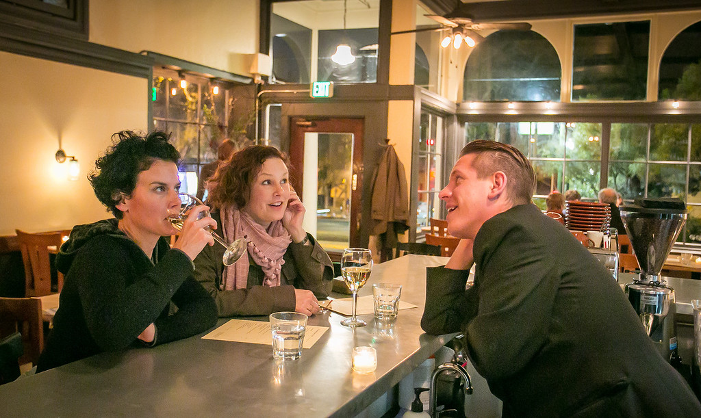 Diners enjoy dinner at the bar at the Hillside Supper Club in San Francisco, Calif. is on Saturday, February 22nd 2013.